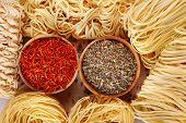 Different dry instant noodles with spices close-up