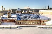 Moscow Old Roofs. Unusual View From The Roofs Of Ilyinka Street On The Gum Roof And The Kremlin Towe