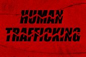 Stop human trafficking - a conceptual grungy image with words breaking