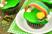 pic of pot gold  - Rainbow pot of gold St Patricks Day cupcake close up on plate - JPG