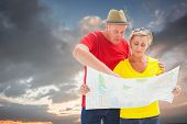 pic of lost love  - Lost tourist couple using map against blue and orange sky with clouds - JPG