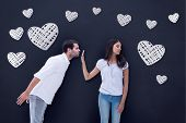 Brunette uninterested in mans advances against blackboard
