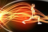 picture of light weight  - Fit woman doing weighted lunges on the beach against curved laser light design in orange - JPG