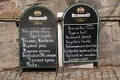 KARLOVY VARY, CZECH REPUBLIC - MAY 8, 2013: Restaurant outdoor menu in German and Russian languages in Karlovy Vary, Czech Republic.