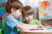 pic of nursery school child  - children boys painting in nursery at home - JPG