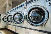 picture of dirty-laundry  - line of laundry machine in the store - JPG