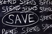 picture of untidiness  - Untidy spend and save message written on a blackboard - JPG