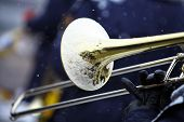 stock photo of trombone  - Color image of a trombone being played on a snowy day - JPG