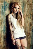 Modern girl with blonde dreadlocks. Jeans style. Modern generation.