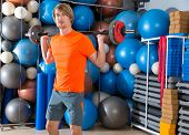 barbell squats blond man at gym exercise workout