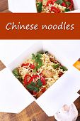 Chinese noodles with vegetables in takeaway boxes and space for your text
