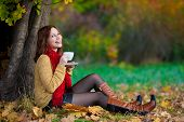 Woman In Beige Sweater And Red Scarf Drink Tea