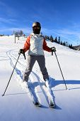 Skier on winter ski resort
