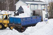 picture of wheel loader  - Wheel loader unloading snow on a truck - JPG