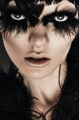 Dark Woman With Black Feathers On Eyes