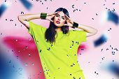 Cute Woman In Neon Green Dress With Pink Lips