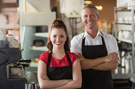 image of cafe  - Servers smiling at the camera at the cafe - JPG