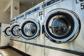 picture of laundromat  - line of laundry machine in the store - JPG