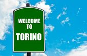 image of torino  - Green road sign with greeting message Welcome to TORINO isolated over clear blue sky background with available copy space - JPG