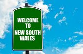 picture of south-pole  - Green road sign with greeting message Welcome to NEW SOUTH WALES against clear blue sky background with available copy space - JPG