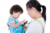 foto of child development  - Young mother carrying her daughter adorable little asian  - JPG