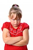 Angry little girl with arms crossed isolated on white