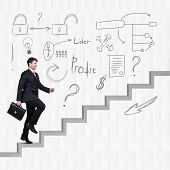 picture of upstairs  - Image of confident businessman with briefcase walking upstairs - JPG
