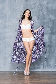 pic of swimsuit model  - Young and beautiful fashion model posing in studio in swimsuit and beach cape - JPG