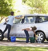 picture of car carrier  - Two Girls Washing Car Together - JPG