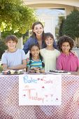 image of 11 year old  - Group Of Children Holding Bake Sale With Mother - JPG