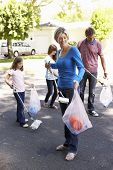 picture of pick up  - Family Picking Up Litter In Suburban Street - JPG