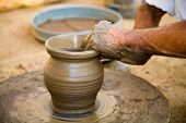 image of rajasthani  - A potter making a ceramics jar near the town of Jodhpur in Rajasthan India - JPG