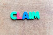 stock photo of reimbursement  - claim colorful word in the wooden background - JPG