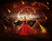 picture of fiery  - woman fire mage in medieval dress with developing mantle conjured fiery meteor rain - JPG
