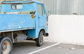 picture of truck-cabin  - Old abandoned blue small truck near the reconstruction area - JPG