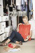 picture of wardrobe  - Teenage Girl Choosing Clothes From Wardrobe In Bedroom - JPG