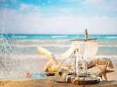 foto of greek  - Traditional Greek ouzo at the beach - JPG