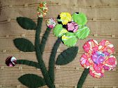 Flowers patch on brown Fabric