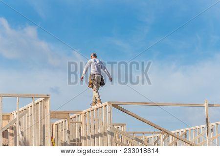 Rear View Roofer Builder Worker