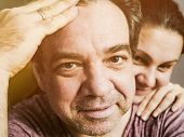 Happy middle-aged man and his wife close-up portrait poster