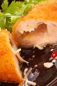 ?lose up of chicken Kiev cutlet