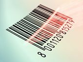 stock photo of laser beam  - Laser beam reading a printed barcode - JPG