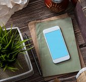 White smartphone mockup on the desktop. Clipping path. poster