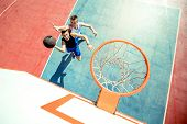 High Angle View Of Basketball Player Dunking Basketball In Hoop. poster