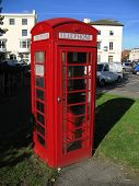Traditional British Telephone Box In Urban Setting