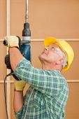 Handyman Home Improvement Working With Jackhammer