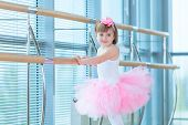Little Ballerina Girl In A Pink Tutu. Adorable Child Dancing Classical Ballet In A White Studio. Chi poster