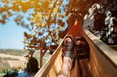 Man Laying And Relaxing In Hammock, Close Up Of Relaxed Male Feet Swinging In Hammock In Summer Morn poster