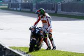 SEPANG, MALAYSIA - FEBRUARY 2: MotoGP rider Marco Simoncelli of the San Carlo Honda Gresini Team inspects his bike at the 2011 MotoGP winter tests at the Sepang Circuit. February 2, 2011 in Malaysia