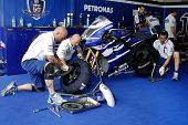 SEPANG, MALAYSIA - FEBRUARY 22: Yamaha Factory Racing mechanics work on Jorge Lorenzo's bike at the